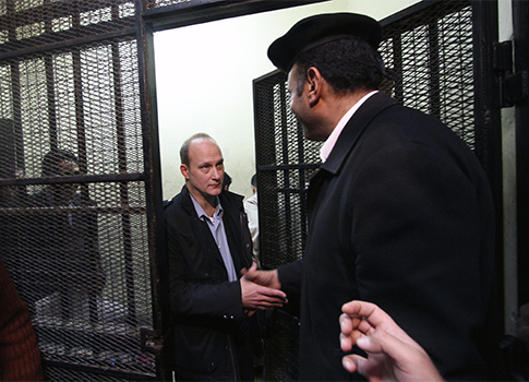 Robert Becker leaves the defendants' cage after a hearing in the trial of employees of nonprofit groups in Egypt / AP
