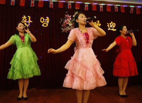 North Korean women sing at a North Korean restaurant in Dandong, China / AP