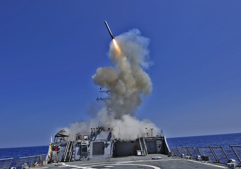 The guided-missile destroyer USS Barry launches a Tomahawk cruise missile / AP