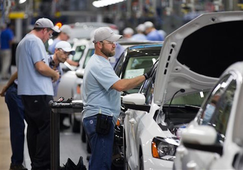 an employee at the Volkswagen plant in Chattanooga, Tenn., works on a Passat sedan