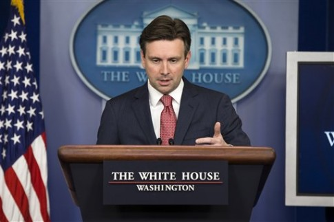 Josh Earnest / AP