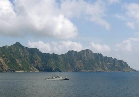 Photo taken from a Kyodo News airplane shows Uotsuri (back), one of the five main islands in the Japanese-controlled Senkaku group, in the East China Sea on Sept. 11, 2013
