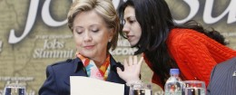 Huma Abedin whispers in Hillary Clinton's ear (AP)