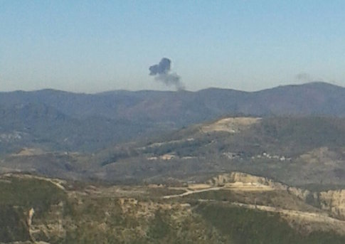 Smoke rises over a mountainous area in northern Syria after a war plane was shot down by Turkish fighter jets near the Turkish-Syrian border / Reuters