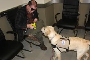 Cpl. Bunce plays with puppy Bunce / Stephen Gutowski