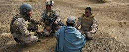 U.S. Marines interview a local Afghan man with the help of a translator / AP