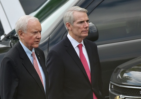Senators Orin Hatch and Rob Portman are seen on West Executive Drive after a briefing for US senators on the situation in North Korea in the Eisenhower Executive Office Building