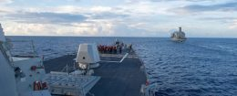 The Arleigh Burke-class guided-missile destroyer USS Dewey prepares for a replenishment-at-sea in the South China Sea