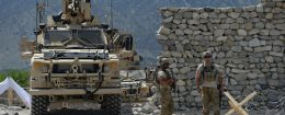 U.S. soldiers patrol near the site of a U.S. bombing during an operation against Islamic State militants in the Achin district of Afghanistan's Nangarhar province