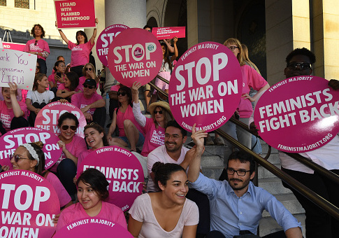 """Supporters and patients of Planned Parenthood take part in a """"Pink the Night Out"""" rally at City Hall, in Los Angeles, California on June 21, 2017. MARK RALSTON/AFP/Getty Images"""