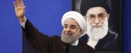 President Hassan Rouhani in front of a portrait of Iran's Supreme Leader Ayatollah Ali Khamenei